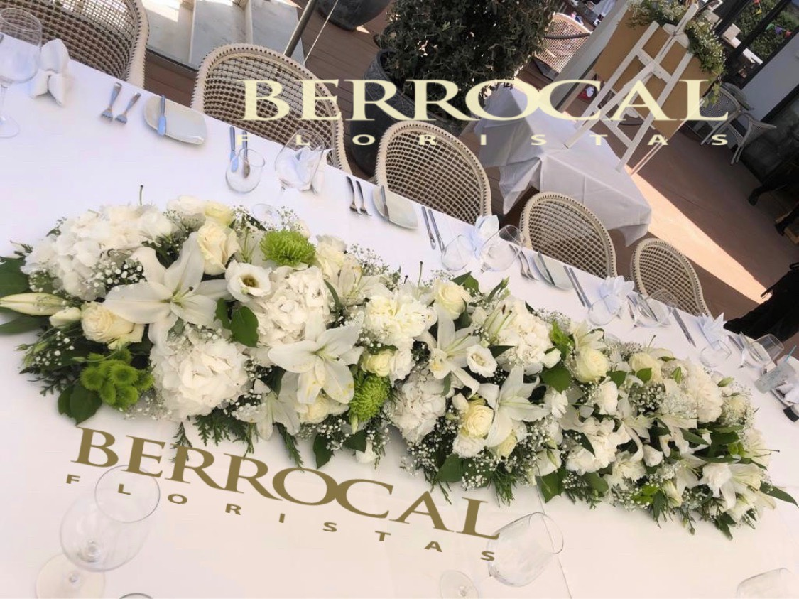 Floral composition main table bride and groom.  Hydrangeas  Liliums  Roses.  Lisianthus  Green.