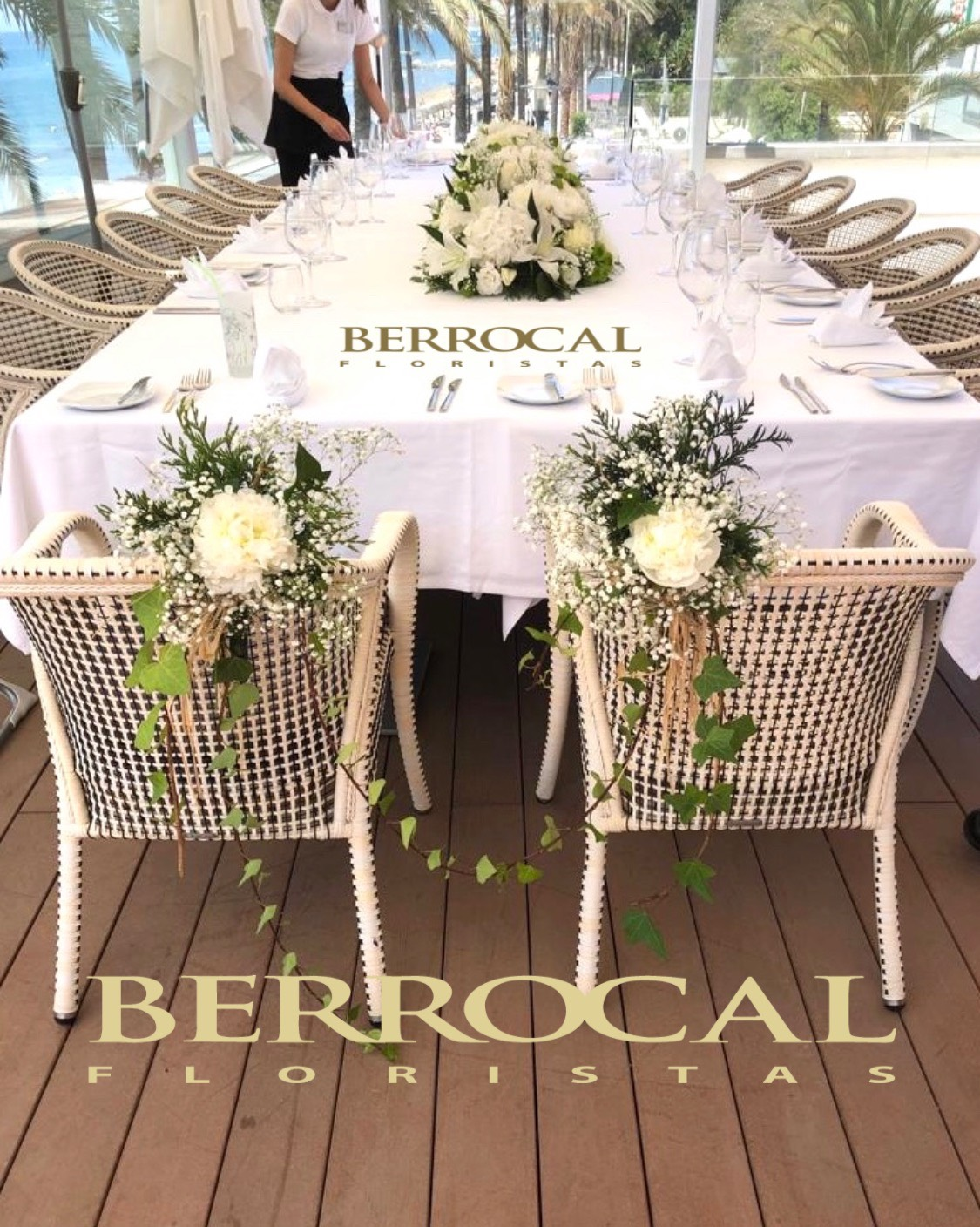 Main/ Top table, floral center and decoration of the bride and groom's chairs.  Hydrangeas  Liliums  Roses.  Lisianthus.  Green.